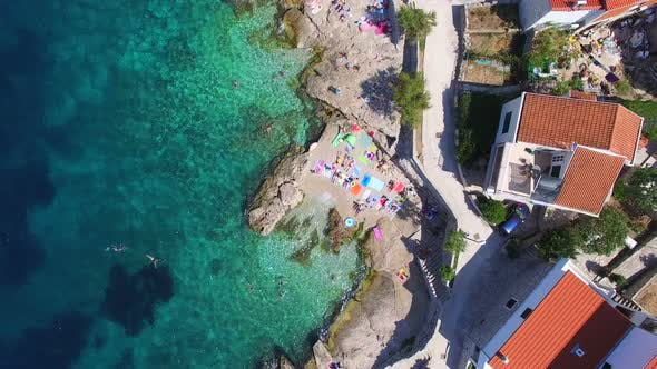 Cover Image for Flying above private beach of Primosten town, Croatia