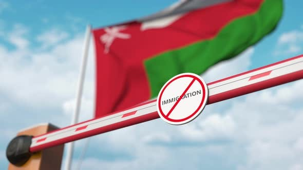 Opening Barrier with Stop Immigration Sign at Flag of Oman