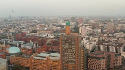 AERIAL: View of Berlin Germany Atrium Tower Potsdamer Platz Skyscraper Cityscape in Beautiful Orange