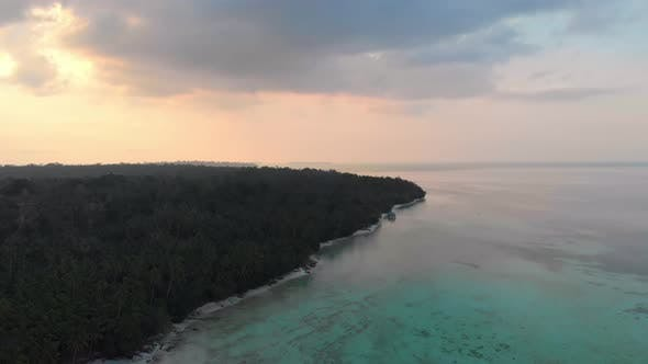 Thumbnail for Aerial: uncontaminated coastline beach sunset at Kei Islands Indonesia