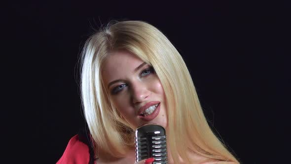Thumbnail for Girl Dances and Sings in a Retro Microphone, Black Background