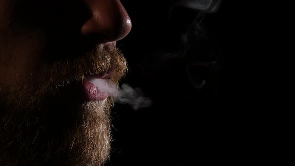 Thumbnail for Man with a Beard Smoking Electronic Cigarette. Black. Close Up