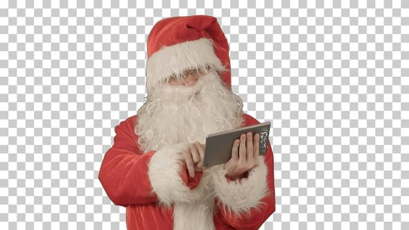 Cheerful Santa Claus is holding a tablet, Alpha Channel