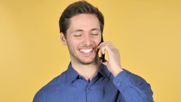 Thumbnail for Man Talking on Phone on Yellow Background