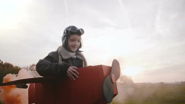 Thumbnail for Little Girl Running in Sunset Field in Plane Costume