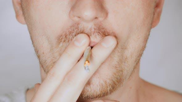 Thumbnail for Close Up Face Fair Man Smoking