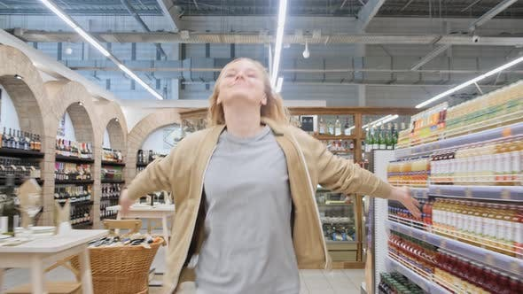 Thumbnail for Woman in the Supermarket Runs Happy Arms Outstretched
