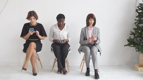 Thumbnail for Three Girls Sitting on Chairs Waiting for a Job Interview