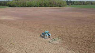 Farming Tractor in the the Field