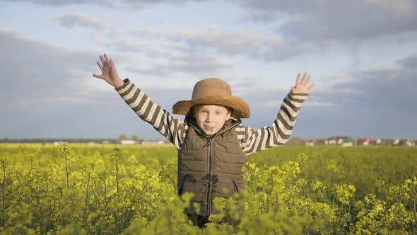 Thumbnail for Boy Jumping in the Field of Rapeseed