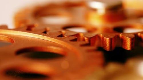 clock 's mechanism- wheels spinning -close up