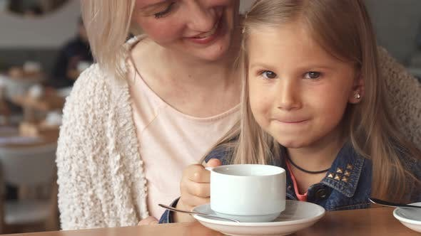 Thumbnail for Little Girl Takes a Sip of Tea at the Cafe