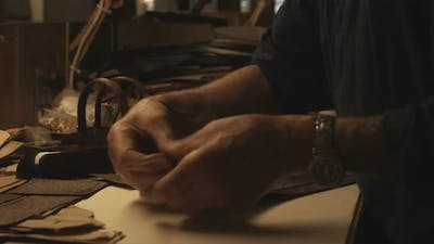 Clip of a craftsman working on a bag in Italy.