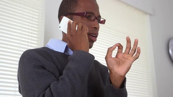 Black business man talking on mobile phone