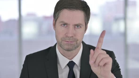 Thumbnail for Portrait of Middle Aged Businessman Saying No with Finger Sign