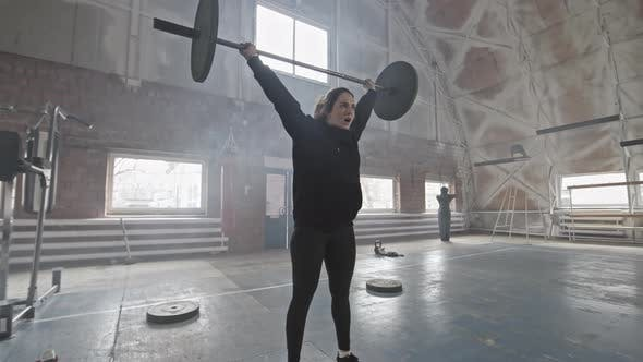 Thumbnail for Woman Doing Overhead Squat with Barbell