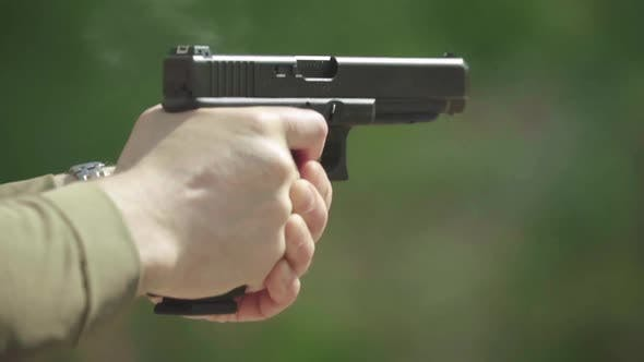 Thumbnail for Close-up Shot of a Pistol. Slow Motion.