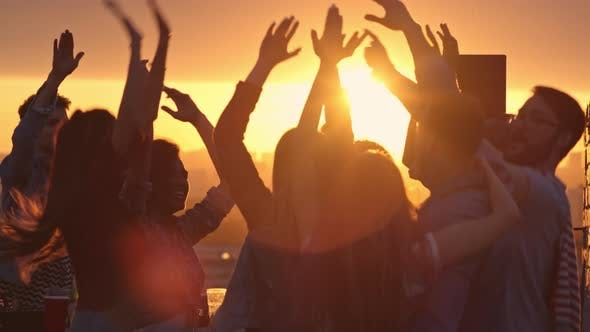 Partying on Rooftop at Sunset