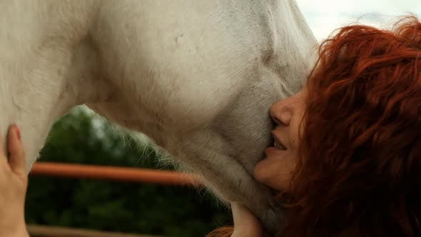 Thumbnail for A Woman Is Engaged in Hippotherapy Outdoors.