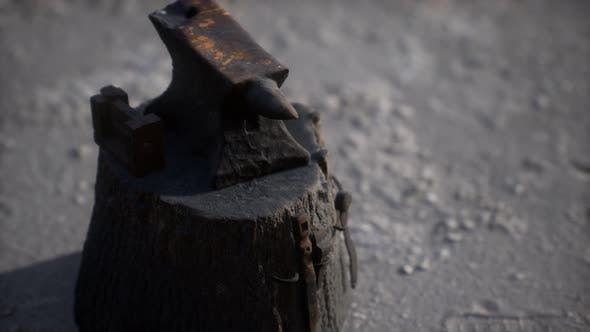 Thumbnail for Old Anvil Attached To a Stump