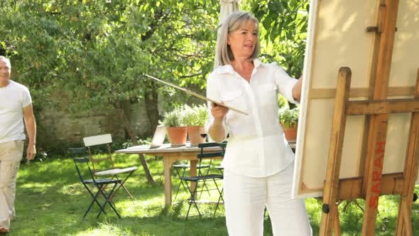 Thumbnail for Mature couple in garden painting