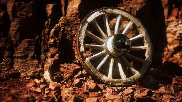 Thumbnail for Old Wooden Cart Wheel on Stone Rocks