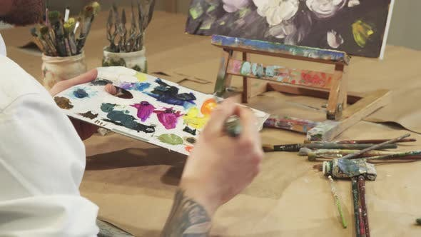 Thumbnail for Shot of a Painter Squeezing Oil Paint on To His Palette