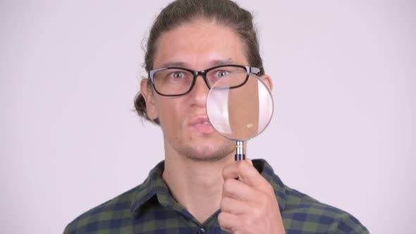 Thumbnail for Face of Handsome Hipster Man Playing with Magnifying Glass