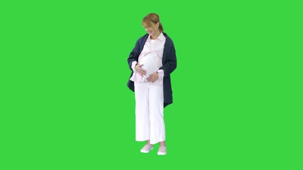 Pregnant Woman Caressing Her Belly Green Screen Chroma Key