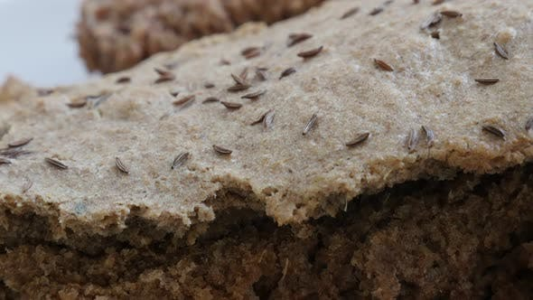 Thumbnail for Panning over  brown staple food detailed surface 4K 2160p 30fps UltraHD footage - Rustic bread crust
