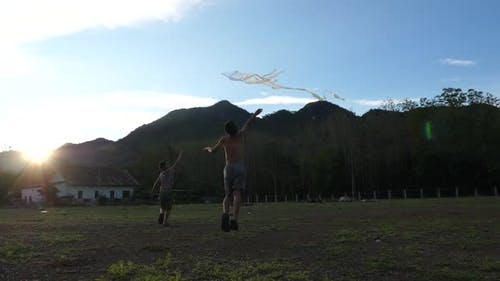 Poor Asian Kids Playing With Kite