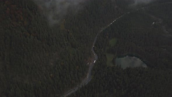 Thumbnail for AERIAL: Scenic View on Highway in Forest,Mountains with Car Traffic, Rainy and Cloudy in Winter