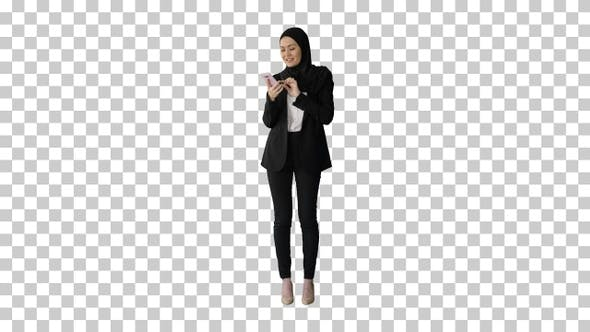 Thumbnail for Muslim girl in hijab using smartphone, Alpha Channel