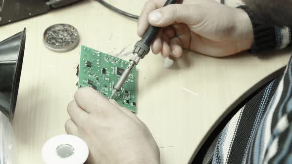 Thumbnail for A Worker Is Working on the Creation of an Electronic Board. Close-up.