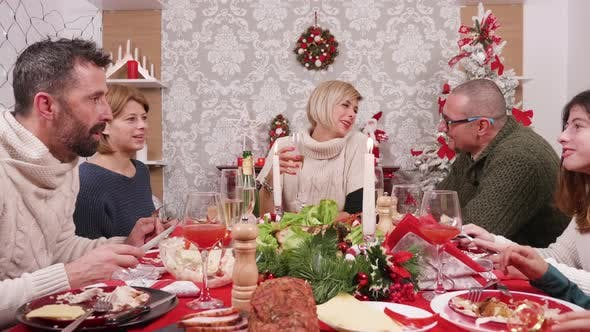 Thumbnail for Christmas Feast with Big Family Gathered Around the Table