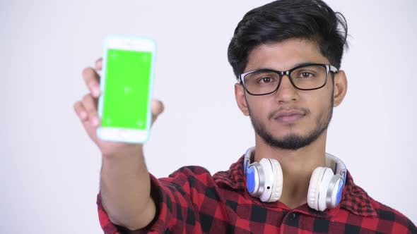 Cover Image for Young Happy Bearded Indian Hipster Man Showing Phone