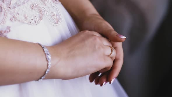 Bride Wearing White Dress and Shiny Bracelet Shows Ring