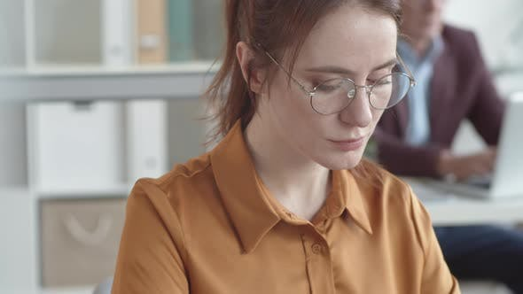 Thumbnail for Focused Young Caucasian Woman Working on Laptop in Office