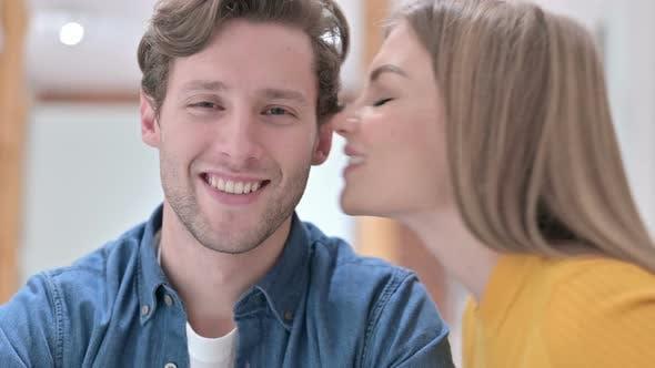 Thumbnail for Portrait of Beautiful Woman Kissing Man on Cheek