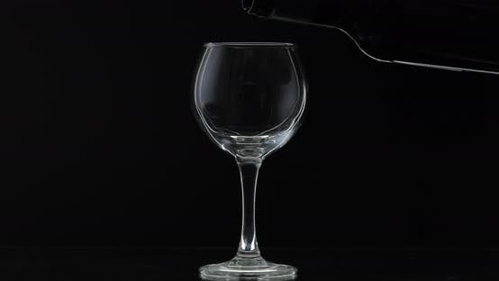 Thumbnail for Rose Wine. Red Wine Pour in Wine Glass Over Black Background