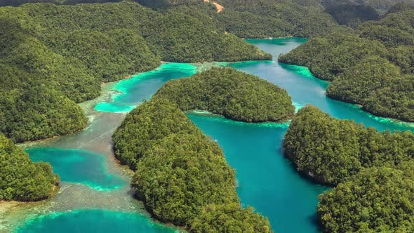 Cover Image for Landscape of Tropical Mountains and Azure Water in Paradise Lagoon. Сoast on the Siargao Island