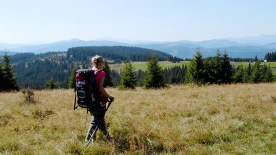 Thumbnail for Woman Hiking in Mountains with Backpack, Enjoying Her Adventure. Slow Motion V4