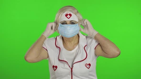 Thumbnail for Elderly Caucasian Female Doctor Wearing Protective Mask. Pandemic. Coronavirus