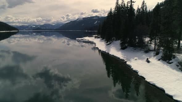 Wilderness Snowmobile Adventure On Edge Of Lake