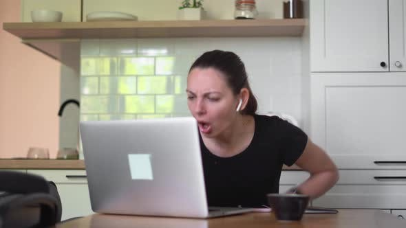 Young Woman with Laptop at Home. Big Stress From News, Unemployment Email, Online Fraud
