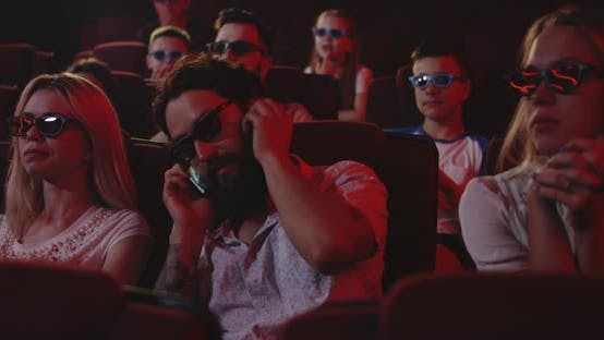 Thumbnail for Man Talking on Cell Phone in a Cinema