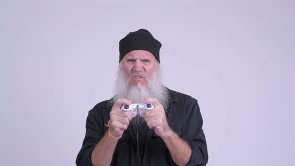 Thumbnail for Mature Bearded Hipster Man Playing Games