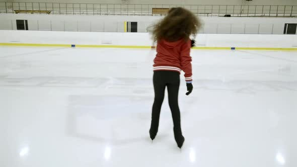 Thumbnail for African Girl Skating on Indoor Ice Rink