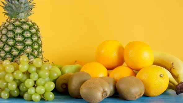 Thumbnail for Variety Mix of Exotic Fruits on Yellow Background