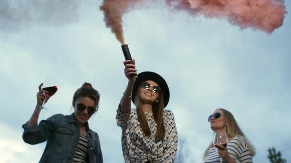 Thumbnail for Three Girls in Pink Billowing Smoke